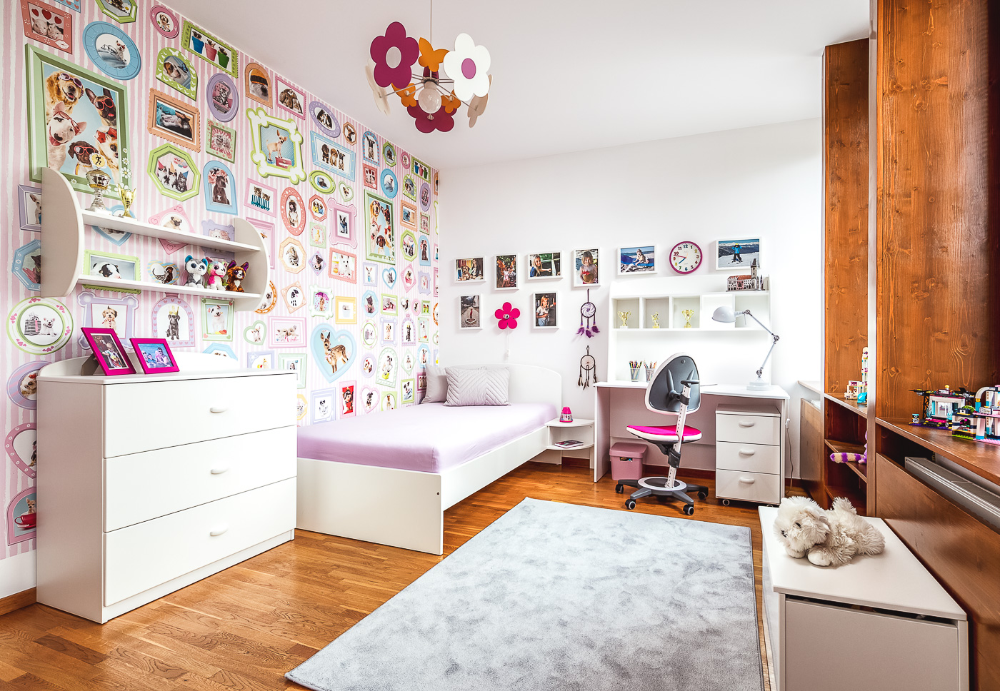 Girls' room with a funny dog-themed wallpaper